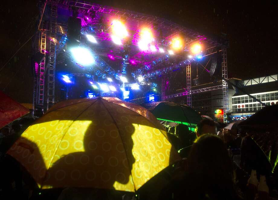 The rain doesn't stop the party at Discovery Green.