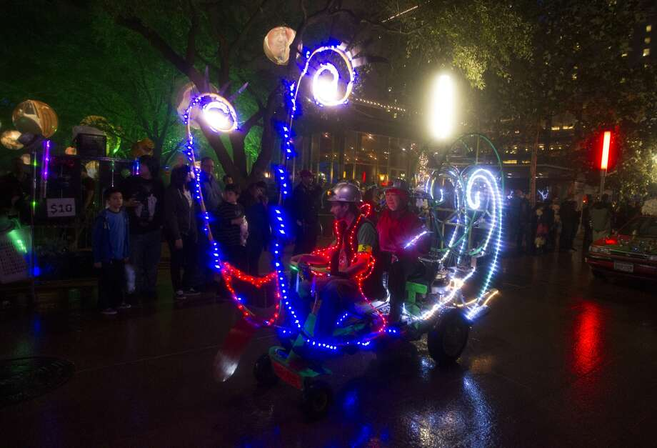 An art car drives the sidewalks during the glow parade at Houston's New Year's Party at Discovery Green.