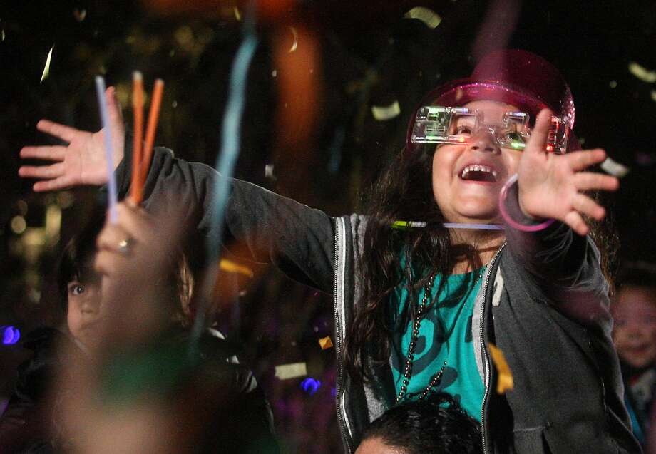Confetti for kids rains on Alyssa Hernandez,  7, at Discovery Green.