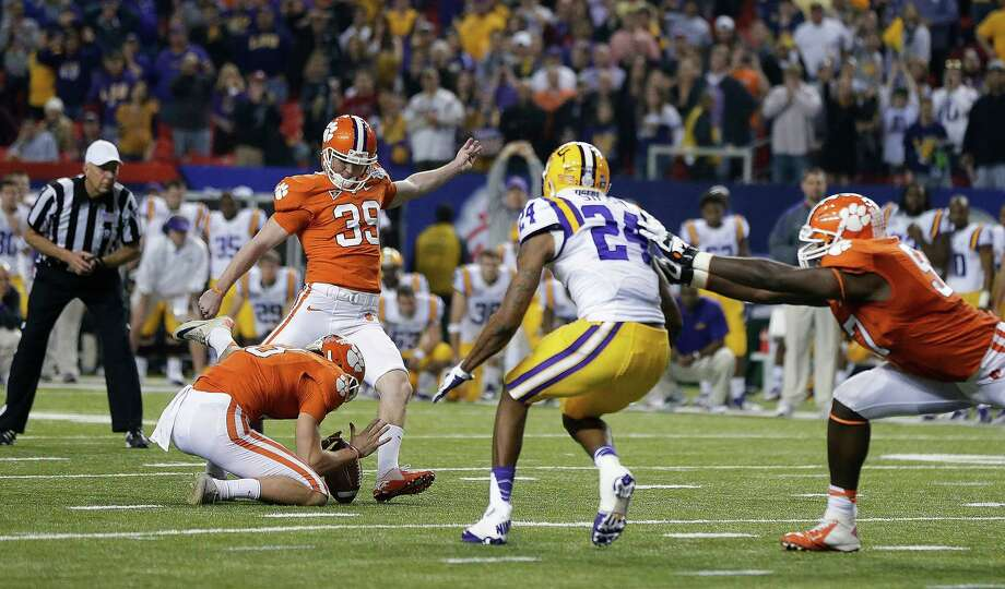 Chick-fil-A Bowl, Dec. 31: Clemson 25, LSU 24; Georgia Dome in Atlanta; Payout: $3,967,000 (ACC), $2,932,500 (SEC) PHOTO: Clemson's Chandler Catanzaro kicks the winning 37-yard field goal against LSU as time expires in the Chick-fil-A Bowl. Photo: David Goldman, Associated Press / AP