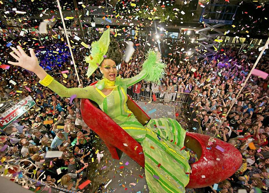 Gary Marion, portraying female impersonator Sushi, hangs in an oversized replica of a woman's red high heel shoe over Duval Street late December 31, 2012, at the Bourbon Street Pub Complex in Key West, Florida. The Red Shoe Drop has become a Key West tradition and is one of five Florida Keys warm-weather takeoffs on New York City's Times Square ball drop marking the beginning of the new year. ( Photo by Andy Newman/Florida Keys News Bureau via Getty Images) Photo: Handout, Getty Images