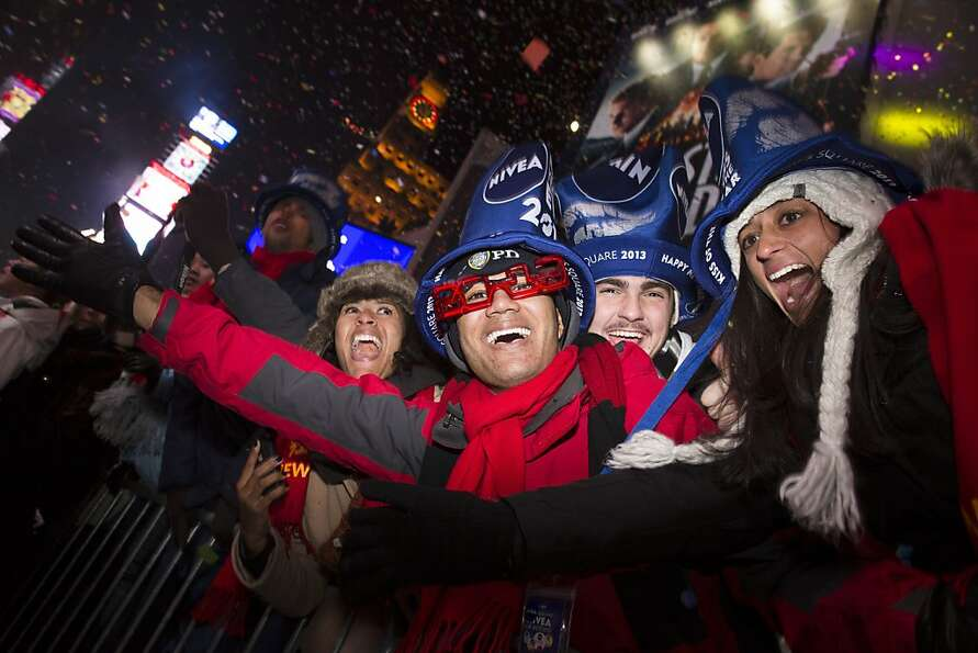 Revelers cheer in Times Square at midnight on New Years Tuesday Jan. 1, 2013, in New York. With fire