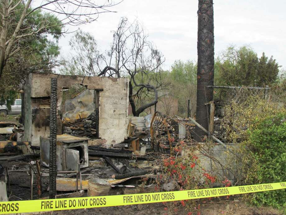 The charred site of a mobile home fire that killed three young children in Hargill, Texas, Sunday is seen Monday, Dec. 31, 2012. Authorities said the preliminary investigation indicates it was accidental and likely an electrical problem. Photo: Christopher Sherman, Associated Press