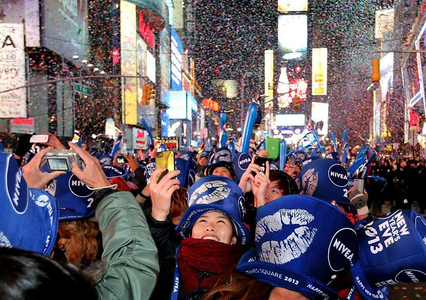 Confetti rains down at the stroke of midnight as thousands gather in Times Square on January 1, 2013