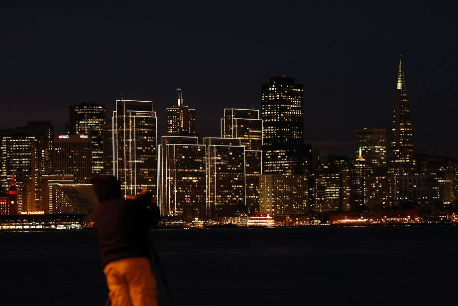 Mike Shaw of San Jose sets up his camera on Treasure Island in preparation for the fireworks coming later near the Embarcadero for New Year's Eve. The Embarcadero was again the focal point of the New Year's celebrations as people from all over the Bay Area came to ring in the new year on Monday, December 31, 2012. Photo: Carlos Avila Gonzalez, The Chronicle