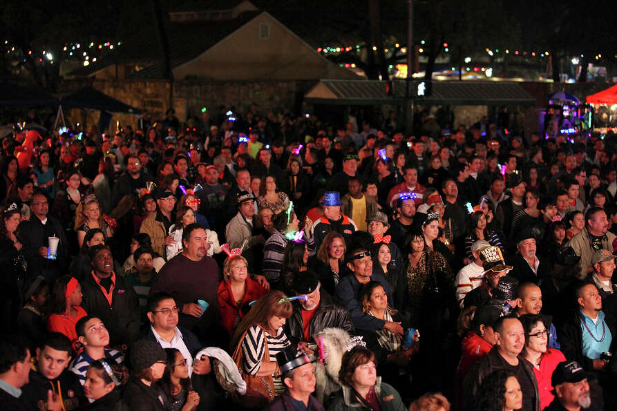 Crowds listen to music during the Celebrate San Antonio event held Monday Dec. 31, 2012.