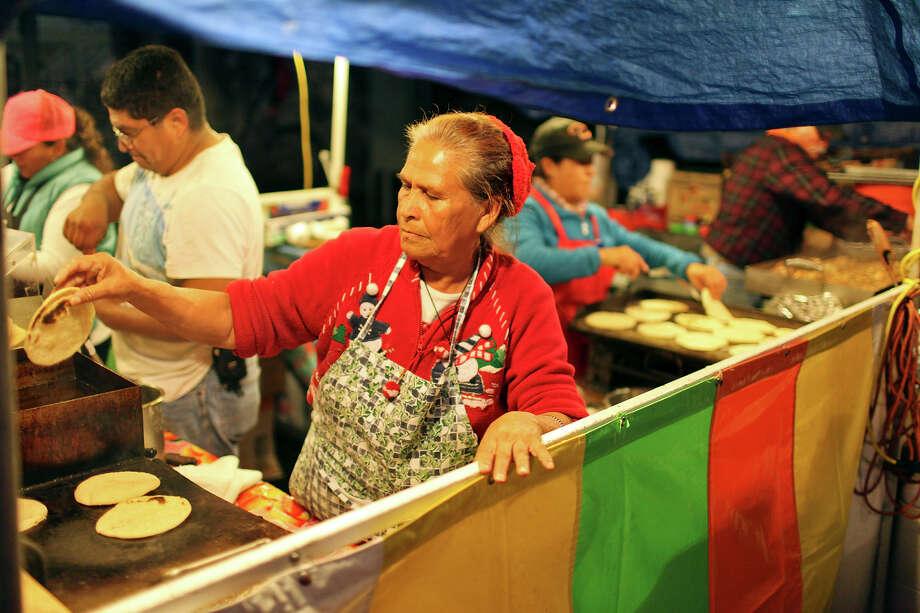Antonia Morales prepares a gordita during the Celebrate San Antonio event held Monday Dec. 31, 2012. Photo: Edward A. Ornelas, San Antonio Express-News / © 2012 San Antonio Express-News