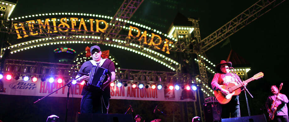 Los TexManiacs' Josh Baca (from left), Gabriel Barajas (background) Max Baca, and Oscar Garcia perform during the Celebrate San Antonio event held Monday Dec. 31, 2012. Photo: Edward A. Ornelas, San Antonio Express-News / © 2012 San Antonio Express-News