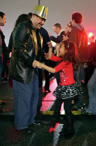 David Marroquin (left) dances with his granddaughter Abra Marroquin, 5,  during the Celebrate San An