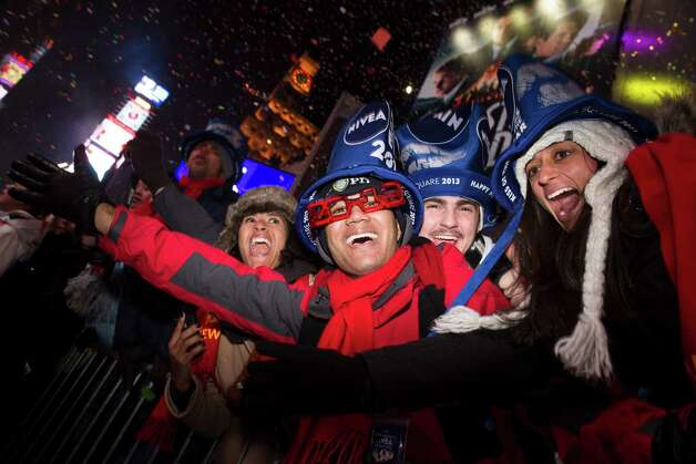 Revelers cheer in Times Square at midnight on New Years Tuesday Jan. 1, 2013, in New York. With fireworks, concerts and celebrations from Hong Kong to New York, revelers welcome 2013 with hope for a better future after a year that thudded to a close with a disastrous storm, gun violence, and talk of economic turmoil from a looming fiscal cliff. This will be the first Times Square countdown in decades without Dick Clark, who died in April, and will be honored with a tribute concert and his name printed on pieces of confetti. Photo: AP