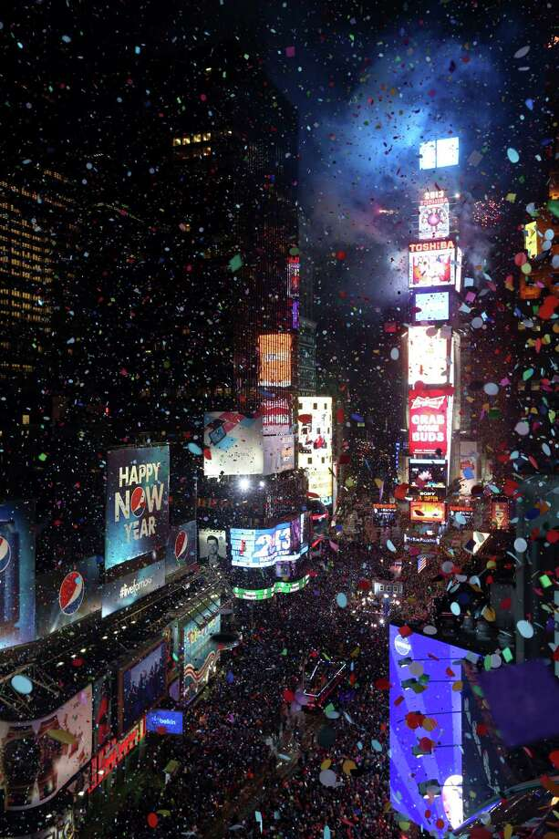Confetti flies over New York's Times Square after the clock strikes midnight during the New Year's Eve celebration as seen from the Marriott Marquis hotel Tuesday, Jan. 1, 2013 in New York. Photo: AP