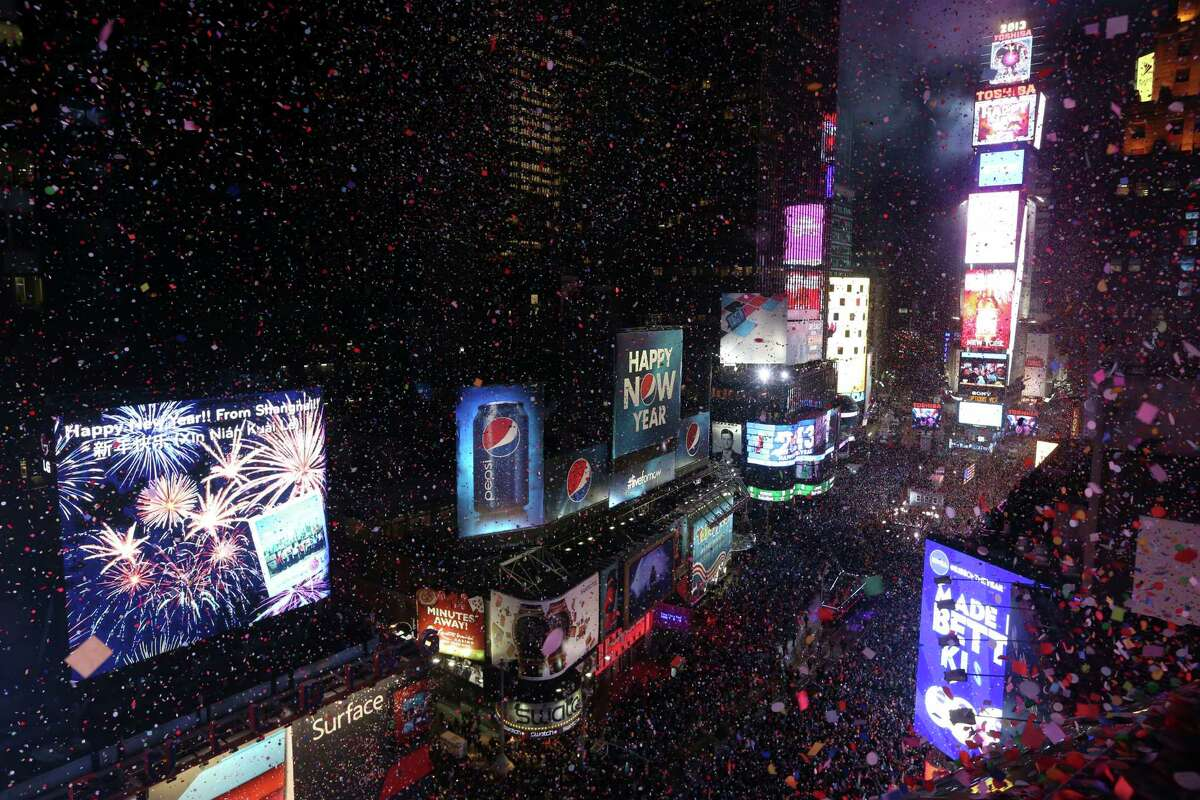 Confetti flies over New York's Times Square after the clock strikes midnight during the New Year's Eve celebration as seen from the Marriott Marquis hotel Tuesday, Jan. 1, 2013 in New York.