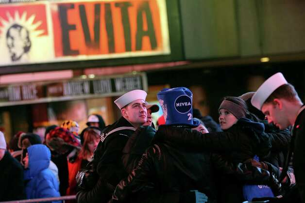 Revelers hug during Times Square New Year's celebration Monday, Dec. 31, 2012 in New York. Photo: AP