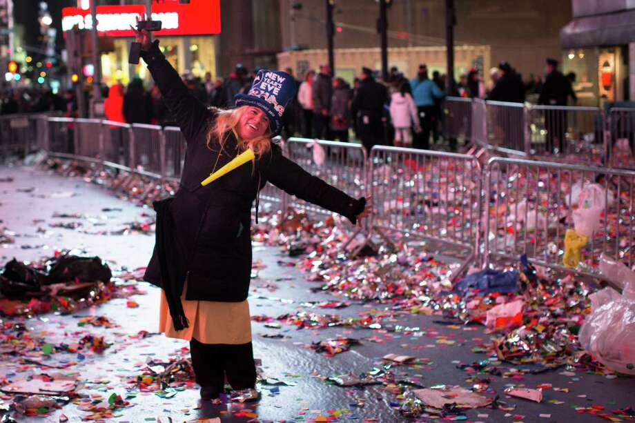 A reveler stands beside emptied barricades, confetti, and debris in Times Square after midnight on New Years Tuesday Jan. 1, 2013, in New York. With fireworks, concerts and celebrations from Hong Kong to New York, revelers welcome 2013 with hope for a better future after a year that thudded to a close with a disastrous storm, gun violence, and talk of economic turmoil from a looming fiscal cliff. This will be the first Times Square countdown in decades without Dick Clark, who died in April, and will be honored with a tribute concert and his name printed on pieces of confetti. Photo: AP