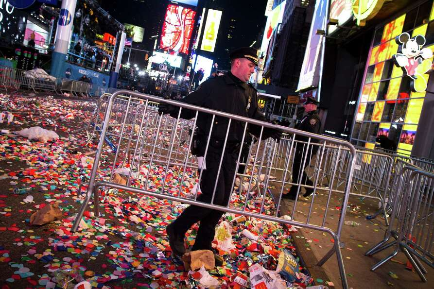 A NYPD officer clears barricades in Times Square after midnight on New Years Tuesday Jan. 1, 2013, i