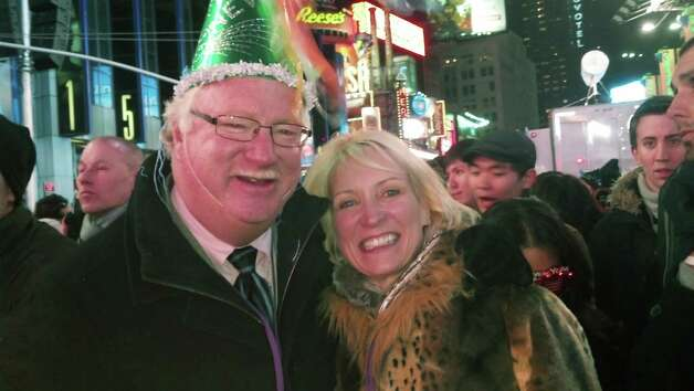 Yvonne Gomez, 53, a physician from Grand Forks, N.D., right, and her husband, 63-year-old potato farmer Greg Halverson pose in New York's Times Square shortly after midnight Jan. 1, 2013. Photo: AP