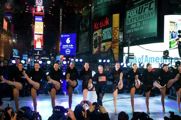 New York Mayor Michael Bloomberg dances with the Radio City Rockettes in Times Square during New Year's celebrations on Tuesday, Jan. 1, 2013 in New York. Photo: Charles Sykes/Invision/AP