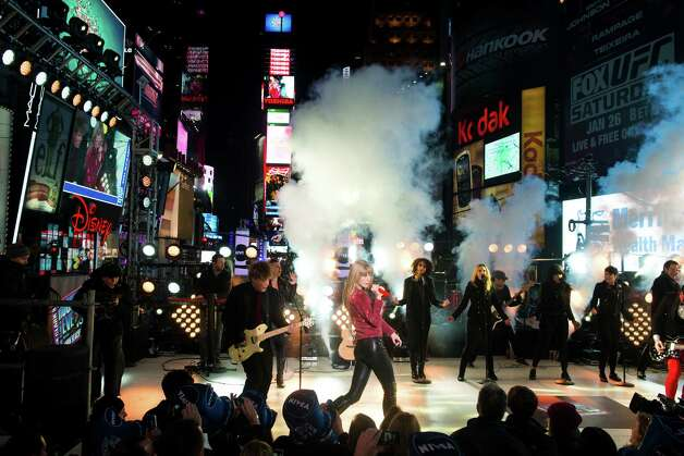 Taylor Swift performs in Times Square during New Year's Eve celebrations on Monday, Dec. 31, 2012 in New York. Photo: Charles Sykes/Invision/AP