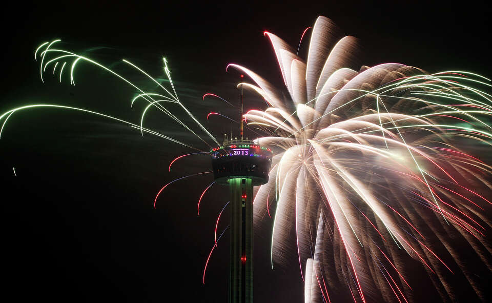 Fireworks explode around the Tower of the Americas during the Valero Corner Stores Fireworks Extrava
