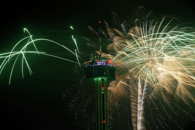 Fireworks explode around the Tower of the Americas during the Valero Corner Stores Fireworks Extravaganza part of the Celebrate San Antonio event Tuesday Jan. 1, 2013. Photo: Edward A. Ornelas, San Antonio Express-News / © 2012 San Antonio Express-News