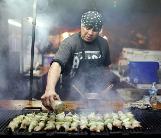 David Benitez cooks chicken kabobs during the Celebrate San Antonio event held Monday Dec. 31, 2012. Photo: Edward A. Ornelas, San Antonio Express-News / © 2012 San Antonio Express-News