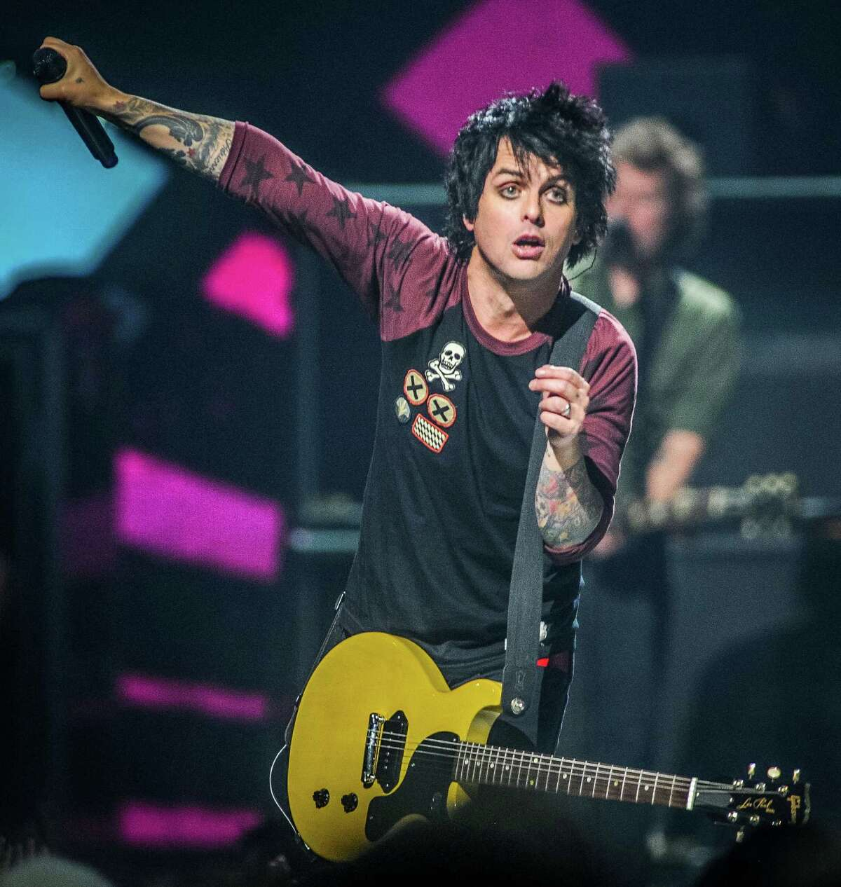 FILE - This Sept. 21, 2012 file photo shows Billie Joe Armstrong of Green Day on stage at the iHeart Radio Music Festival at the MGM Grand Arena in Las Vegas. The Grammy-winning punk band announced new tour dates, Monday, Dec. 31, 2012. Green Day's tour is scheduled to begin in March 28, 2013, in Chicago. (Photo by Eric Reed/Invision/AP, file)