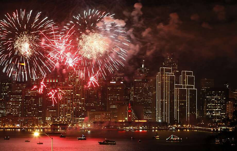 Fireworks light up San Francisco Bay as the west coast city rings in the New Year 2013. The Embarcadero was again the focal point of the New Year's celebrations as people from all over the Bay Area came to ring in the new year on Tuesday, January 1, 2013. Photo: Carlos Avila Gonzalez, The Chronicle