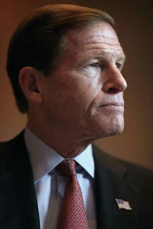 "Sen. Richard Blumenthal (D-CT) participates in a news conference about preserving Medicaid funding during the ""fiscal cliff"" negotiations at the Dirksen Senate Office Building on Capitol Hill December 11, 2012 in Washington, DC. Democratic legislators from the Senate and House were joined by representatives from major unions and policy organizations in calling on the White House and Congressional negotiators to protect funding for Medicaid, a health program for people and families with low incomes and resources.  (Photo by Chip Somodevilla/Getty Images) Photo: Chip Somodevilla, Getty Images / 2012 Getty Images"