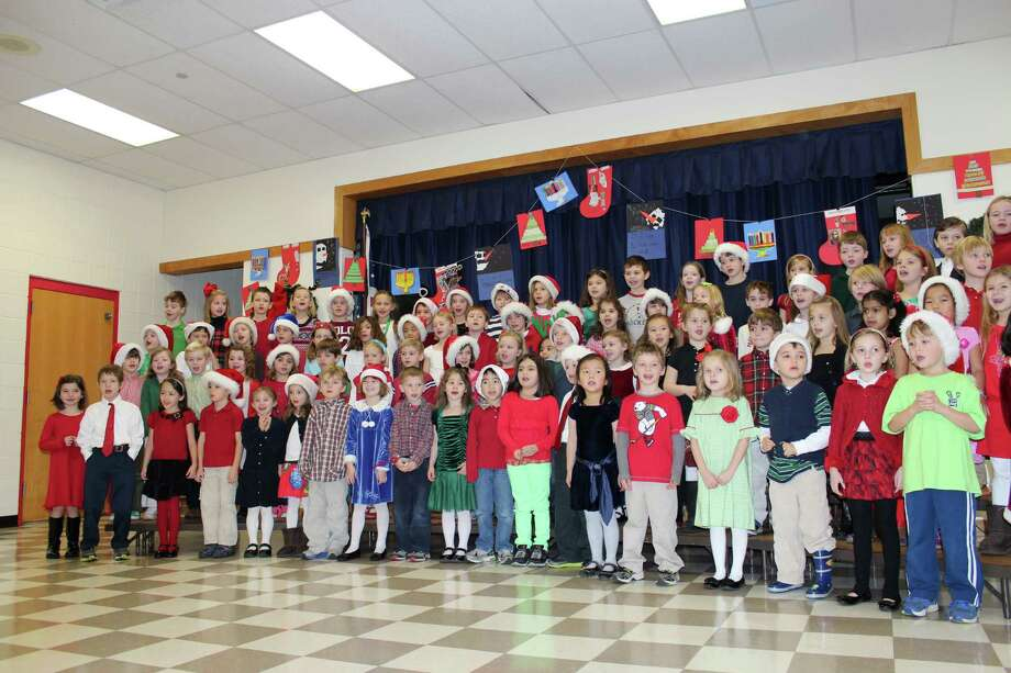 "The first-graders at Holmes School had their holiday concert in the school's Common Room, where they sang a number of holiday favorites, including ""All I Want for Christmas is my Two Front Teeth,"" which got a lot of laughs from the crowd. Photo: Contributed"