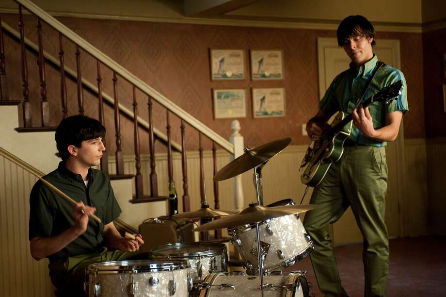 "John Magaro as Douglas (left)  and Jack Huston as Eugene  perform in a band in ""Not Fade Away,"" based on  David Chase's experience as a teenage drummer and bass player. Photo: Courtesy, Paramount Vantage / Paramount Vantage"