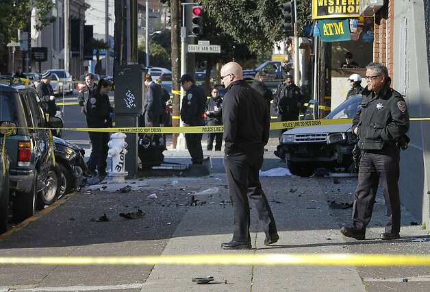 San Francisco Police Chief Greg Suhr, (center) walks the scene as police investigate a two car vehicle crash that left two people dead in San Francisco, Calif. at the corner of 21St. and South Van Ness Ave. on Tuesday Jan. 1,  2013. Photo: Michael Macor, The Chronicle