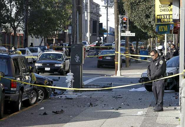 San Francisco police investigate the scene of a two car vehicle crash that left two people dead in San Francisco, Calif. at the corner of 21 St. and South Van Ness Ave. on Tuesday Jan. 1, 2013. Photo: Michael Macor, The Chronicle