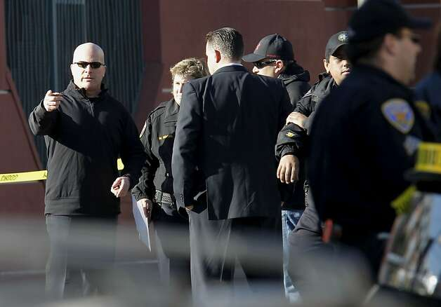 San Francisco Police Chief Greg Suhr, (left) on the scene as police investigate a two car vehicle crash that left two people dead in San Francisco, Calif. at the corner of 21 St. and South Van Ness Ave. on Tuesday Jan. 1, 2013. Photo: Michael Macor, The Chronicle