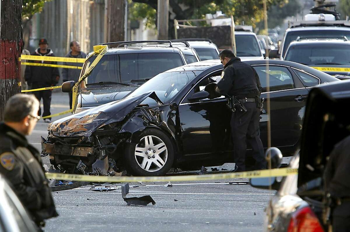 San Francisco Police investigate the suspect's vehicle at the scene of a two car vehicle crash that left two people dead in San Francisco, Calif. at the corner of 21 St. and South Van Ness Ave. on Tuesday Jan. 1, 2013.
