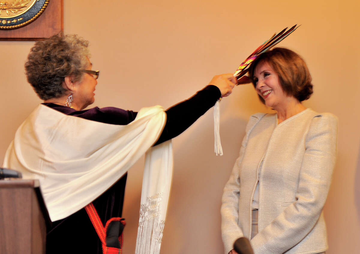 Newly elcted 438th Judicial District Court Judge Gloria Saldana (right) is blessed by Gloria Camarillo Vasquez, Elder of The Tap Pilam Coahuiltecan Nation during sweaing-in ceremonies Tuesday.