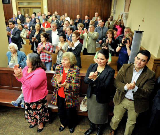 Supporters give a standing ovation to newly elected 73rd Judicial District Court Judge David Canales during his swearing-in ceremony Tuesday. Photo: Robin Jerstad