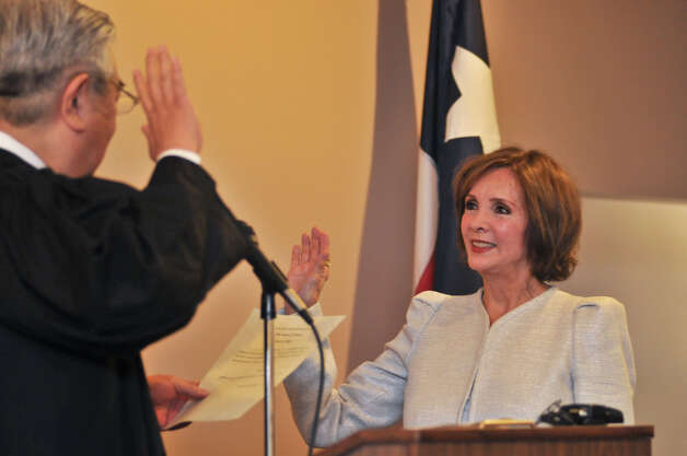 Newly elected 438th Judicial District Judge Gloria Saldana (right) takes the oath of office from Judge Peter Sakai during swearing-in ceremonies Tuesday. Photo: Robin Jerstad