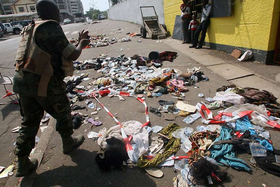 Clothing is spread across the pavement at the scene of a stampede in Abidjan, Ivory Coast, where 60 people died and more than 200 were hurt as people panicked leaving the show. Photo: Herve Sevi, AFP/Getty Images