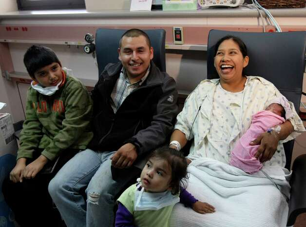 Maritza Guevara born at 12:01 am was the first baby born in the new year.  She was born eight weeks early and weighs four pounds and eight ounces and is 17 inches long.  Parents Maria Ramirez and Miguel Guevara have two older children, Aldo 10 and Lucinda, 2.  Martiza was born the day after her mom's birthday. Photo: Helen L. Montoya, SAN ANTONIO EXPRESS-NEWS / SAN ANTONIO EXPRESS-NEWS