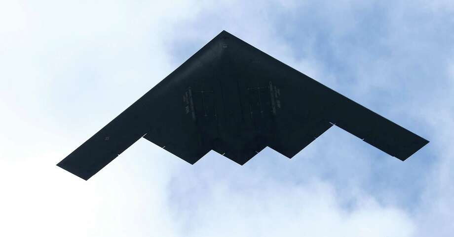 PASADENA, CA - JANUARY 01:  A stealth bomber airplane flies over the parade route during the 124th Rose Parade Presented By Honda on January 1, 2013 in Pasadena, California. Photo: Frederick M. Brown, Getty Images / 2013 Getty Images