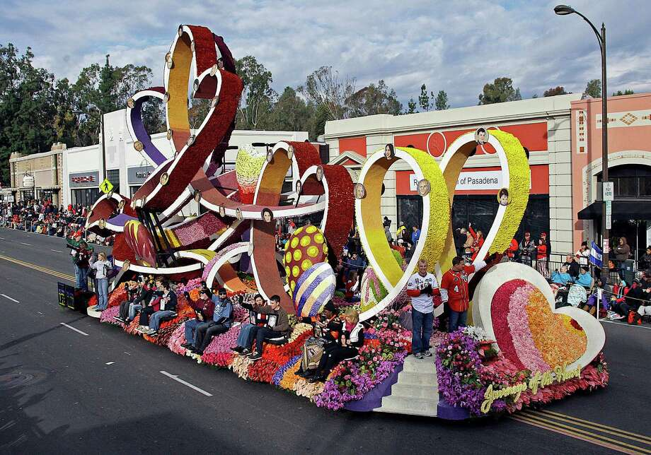 "The Donate Life float ""Journeys of the Heart"" carries people who have received donated organs and relatives of donors in the 124th Rose Parade in Pasadena, Calif., Tuesday, Jan. 1, 2013.  (AP Photo/Reed Saxon) Photo: Reed Saxon, Associated Press / AP"