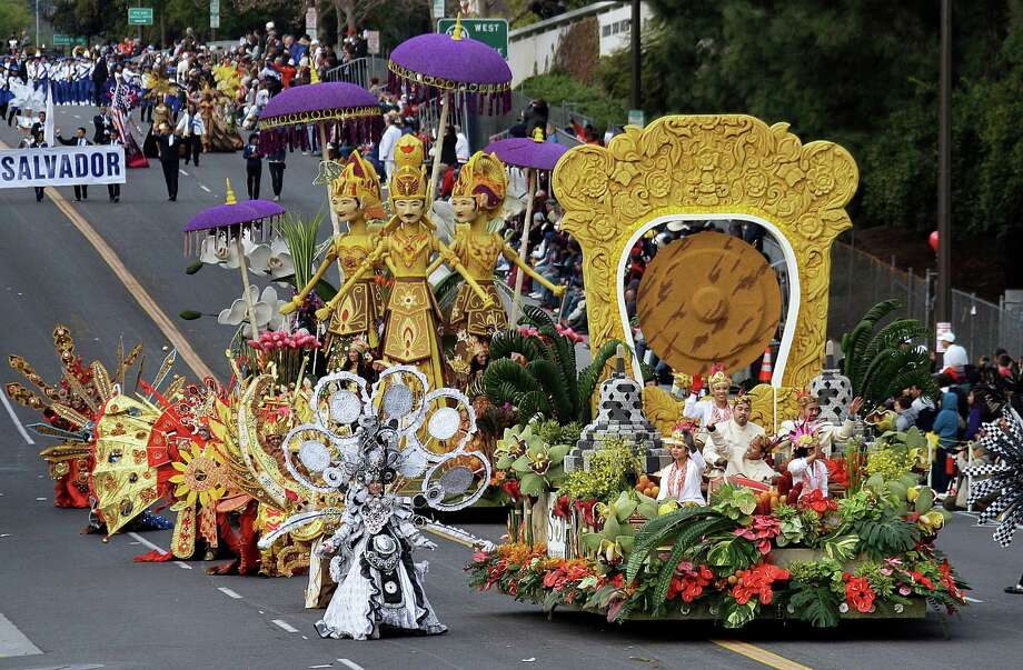 """The Indonesia Ministry of Tourism float """"Wonderful Indonesia,"""" the winner of the President's trophy for the most innovative use and presentation of flowers, appears in the 124th Rose Parade in Pasadena, Calif., Tuesday, Jan. 1, 2013.  (AP Photo/Reed Saxon) Photo: Reed Saxon, Associated Press / AP"""