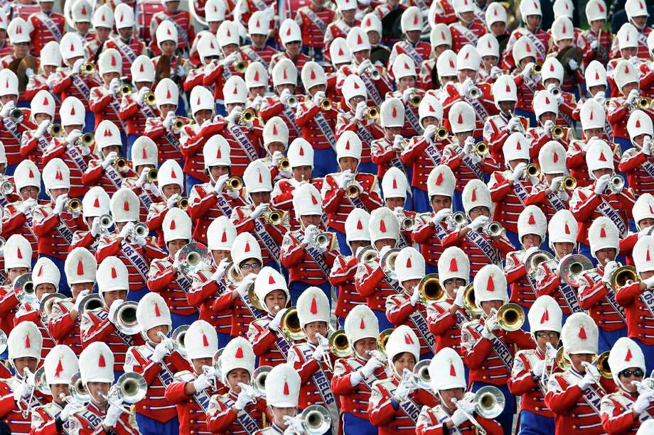The Los Angeles Unified School District All-City Honor Band performs in the 124th Rose Parade in Pasadena, Calif., Tuesday, Jan. 1, 2013. (AP Photo/Patrick T. Fallon) Photo: Patrick T. Fallon, Associated Press / FR160581 AP