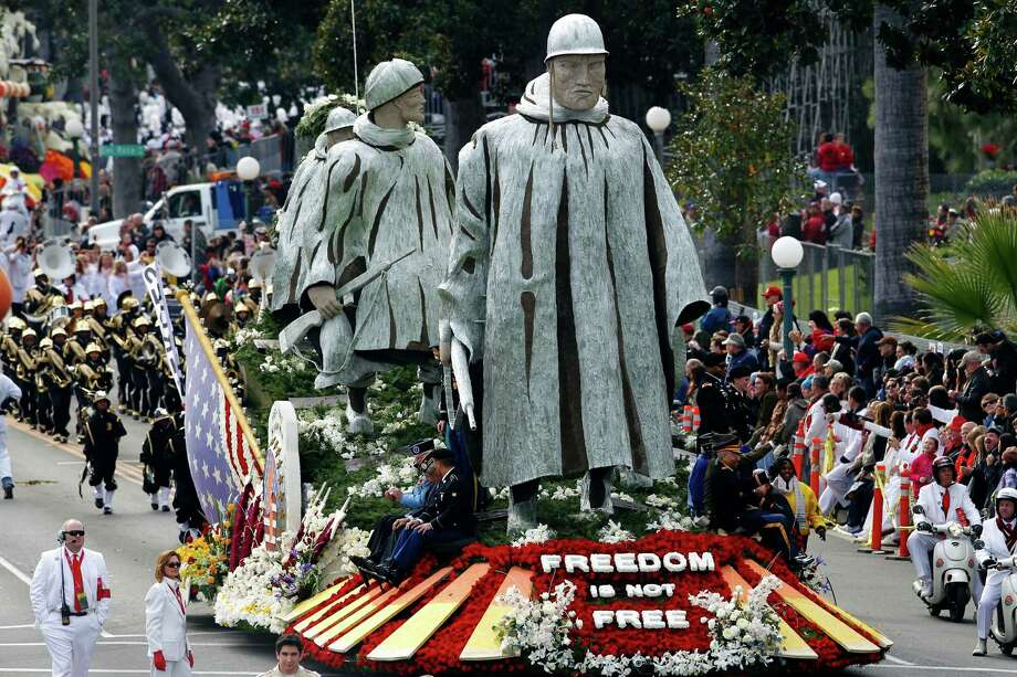 "The float ""Freedom Is Not Free, "" sponsored by the Korean War Commemoration Committee, appears in the 124th Rose Parade in Pasadena, Calif., Tuesday, Jan. 1, 2013. (AP Photo/Patrick T. Fallon) Photo: Patrick T. Fallon, Associated Press / FR160581 AP"