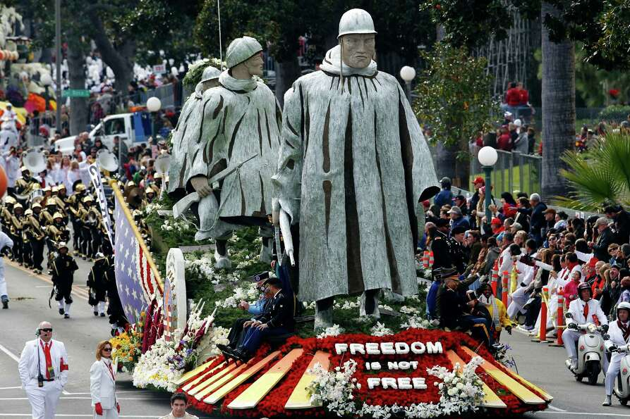 "The float ""Freedom Is Not Free, "" sponsored by the Korean War Commemoration Committee, appears i"