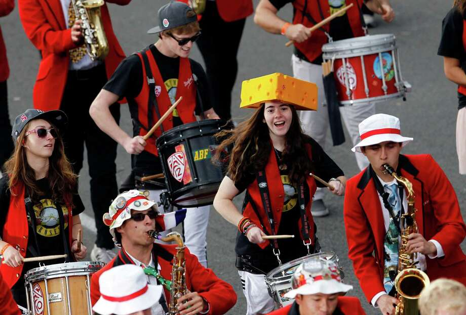 A member of the Stanford University Marching Band wears a Wisconsin Cheese head hat while performing in the 124th Rose Parade in Pasadena, Calif., Tuesday, Jan. 1, 2013. (AP Photo/Patrick T. Fallon) Photo: Patrick T. Fallon, Associated Press / FR160581 AP