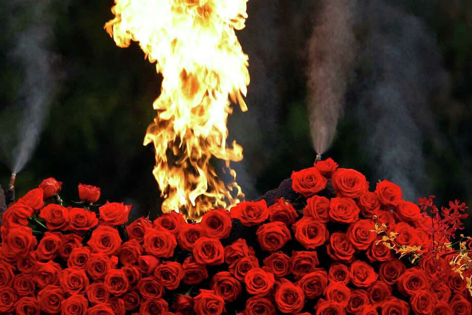 A flame shoots out above a rose volcano on the Dole Dreaming of Paradise float, winner of the Sweepstakes trophy for the most beautiful entry in the 124th Rose Parade, in Pasadena, Calif., Tuesday, Jan. 1, 2013.  (AP Photo/Patrick T. Fallon) Photo: Patrick T. Fallon, Associated Press / FR160581 AP