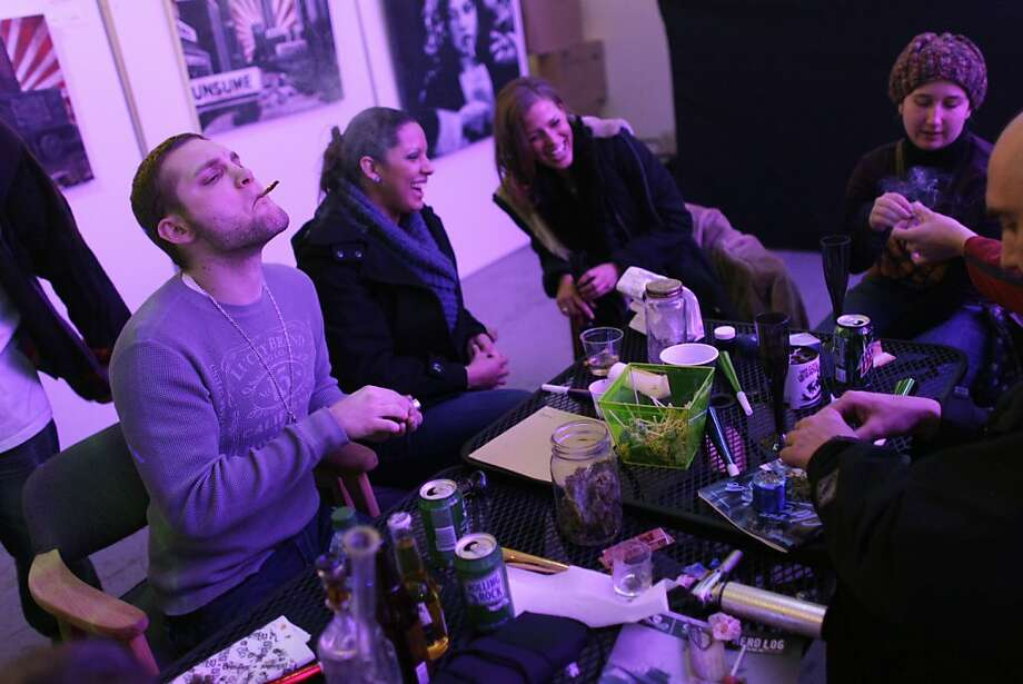 Partygoers smoke marijuana on Monday's official opening night of Club 64 in Denver. The club's events cost $29.99. Photo: Brennan Linsley, Associated Press