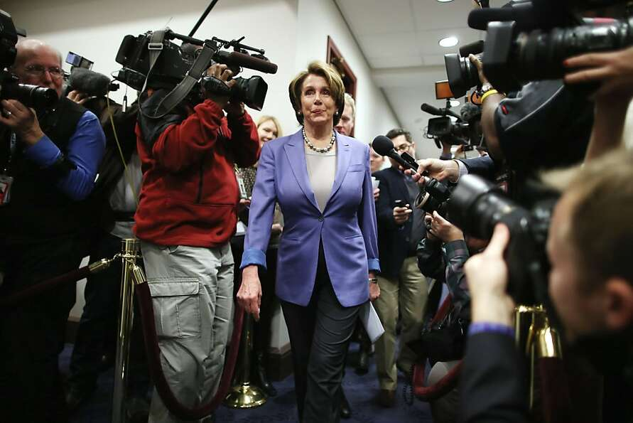 Minority Leader Nancy Pelosi arrives for a House Democratic caucus meeting before the vote. Ultimate