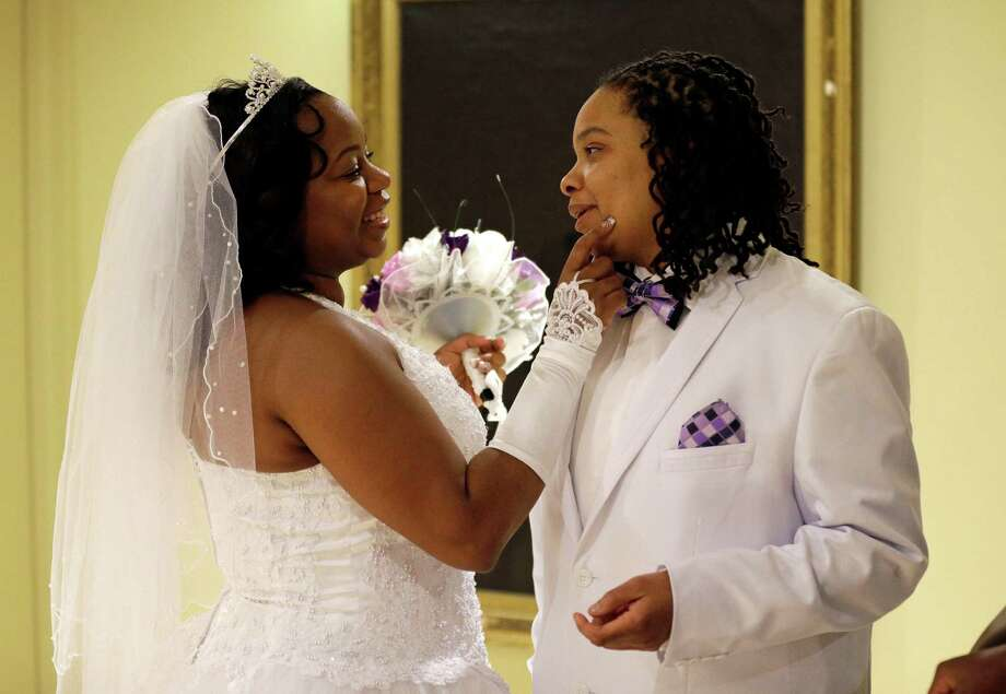 Darcia Anthony, left, and her partner, Danielle Williams, chat before participating in a marriage ceremony on Tuesday at City Hall in Baltimore. Photo: Patrick Semansky, STF / AP